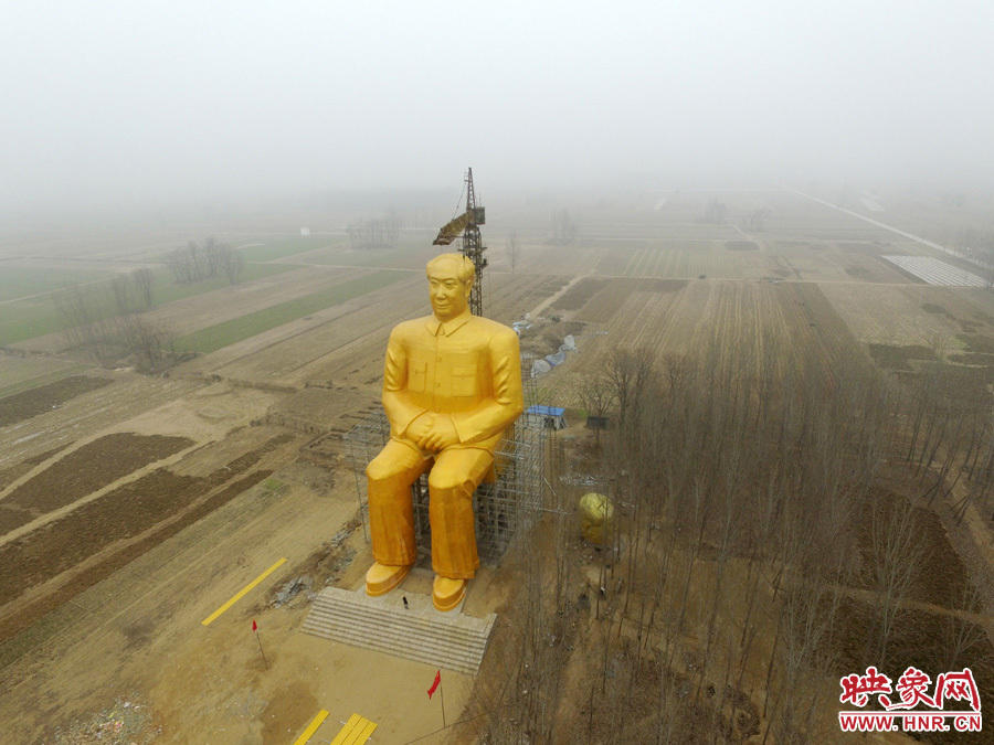 huge mao tsetung statue in china rural village